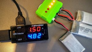 Photo of a usb voltmeter ammeter and a battery charger.